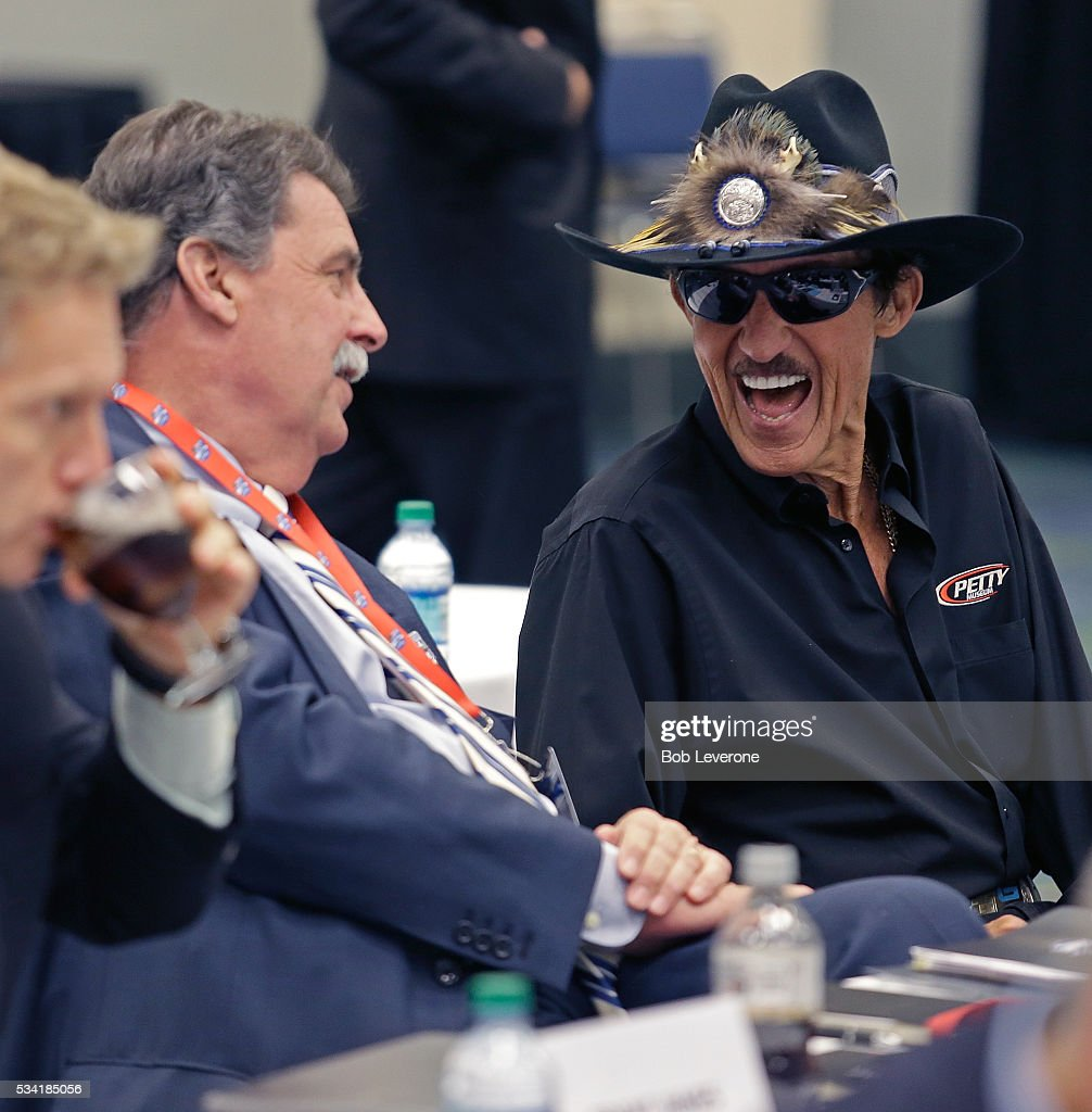 Mike Helton, vice-chairman of NASCAR, gets a laugh out of Hall of Fame driver <a gi-track='captionPersonalityLinkClicked' href=/galleries/search?phrase=Richard+Petty&family=editorial&specificpeople=208957 ng-click='$event.stopPropagation()'>Richard Petty</a> just before a meeting of NASCAR Hall of Fame voters at the Charlotte Convention Center on May 25, 2016 in Charlotte, North Carolina.