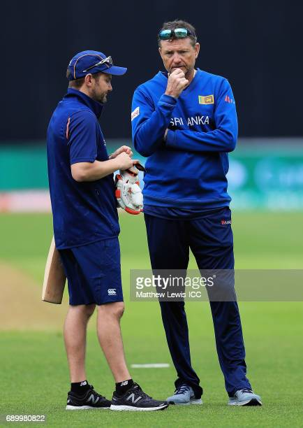 Mike Hesson Coach of New Zealand talks to Graham Ford Coach of Sri Lanka during the ICC Champions Trophy Warmup match between New Zealand and Sri...
