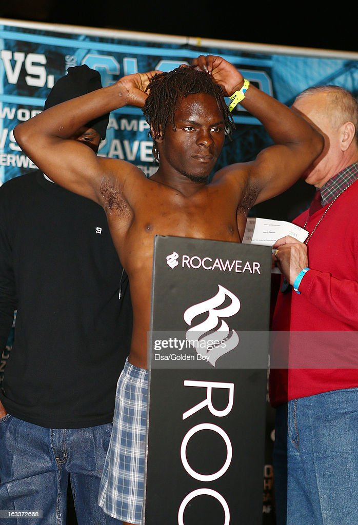 Mike Hill stands on the scale during the weigh in on March 8, 2013 at the Barclays Center in the Brooklyn borough of New York City.