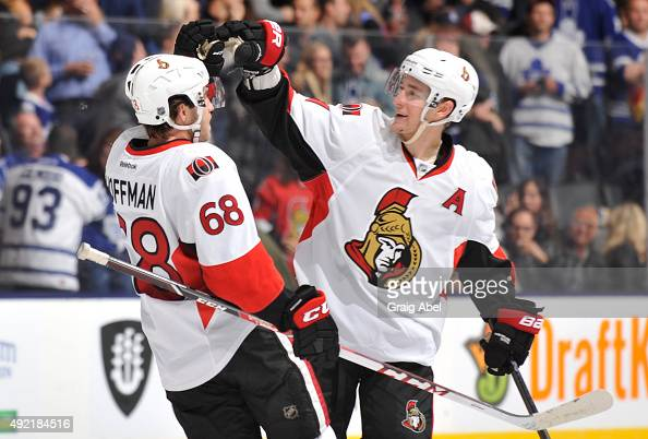 Mike Hoffman and Kyle Turris of the Ottawa Senators celebrate the teams win over the Toronto Maple Leafs during NHL game action October 10 2015 at...