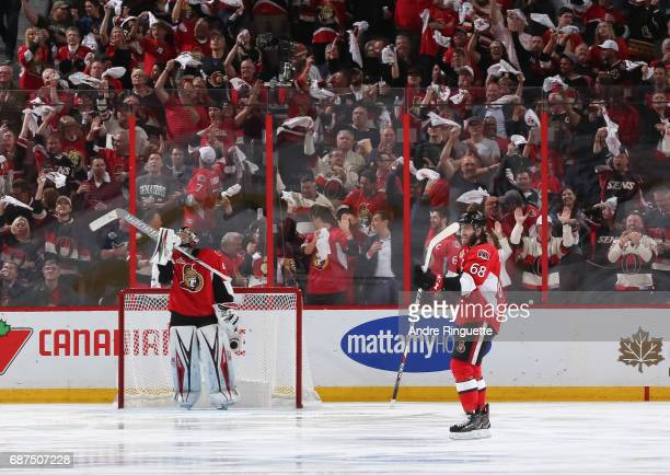 Mike Hoffman of the Ottawa Senators celebrates after scoring on the Pittsburgh Penguins with teammate Craig Anderson looking on in Game Six of the...