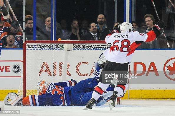 Mike Hoffman of the Ottawa Senators celebrates after scoring the gamewinning goal in overtime against Ben Scrivens of the Edmonton Oilers during an...