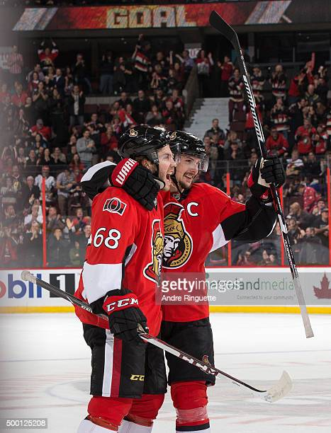 Mike Hoffman of the Ottawa Senators celebrates his lastminute gametying goal against the New York Islanders with teammate Erik Karlsson at Canadian...