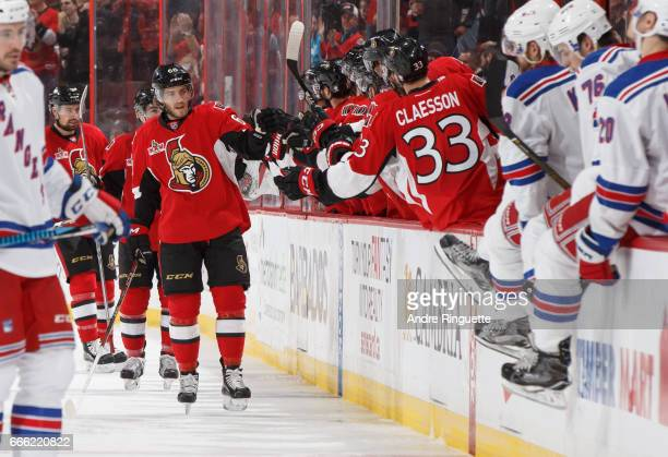 Mike Hoffman of the Ottawa Senators celebrates his second period goal against the New York Rangers with teammates at the players bench at Canadian...