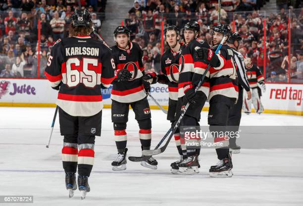 Mike Hoffman of the Ottawa Senators celebrates his third period power play goal against the Pittsburgh Penguins with teammates Erik Karlsson Kyle...