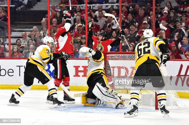 Mike Hoffman of the Ottawa Senators celebrates with Alex Burrows after scoring a goal against MarcAndre Fleury of the Pittsburgh Penguins during the...