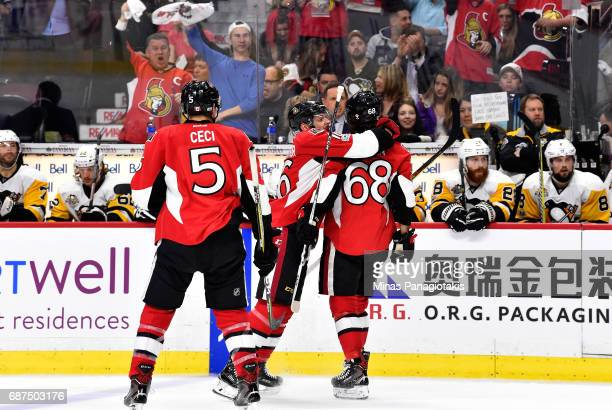 Mike Hoffman of the Ottawa Senators celebrates with his teammate Clarke MacArthur after scoring a goal on Matt Murray of the Pittsburgh Penguins...