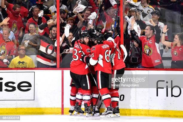 Mike Hoffman of the Ottawa Senators celebrates with his teammates after scoring a goal against MarcAndre Fleury of the Pittsburgh Penguins during the...