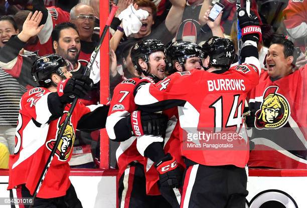 Mike Hoffman of the Ottawa Senators celebrates with his teammates Kyle Turris Alex Burrows and Fredrik Claesson after scoring a goal against...
