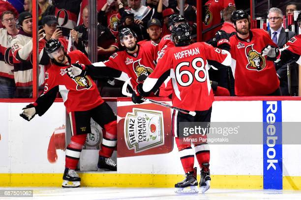 Mike Hoffman of the Ottawa Senators celebrates with teammate Erik Karlsson after scoring a goal on Matt Murray of the Pittsburgh Penguins during the...