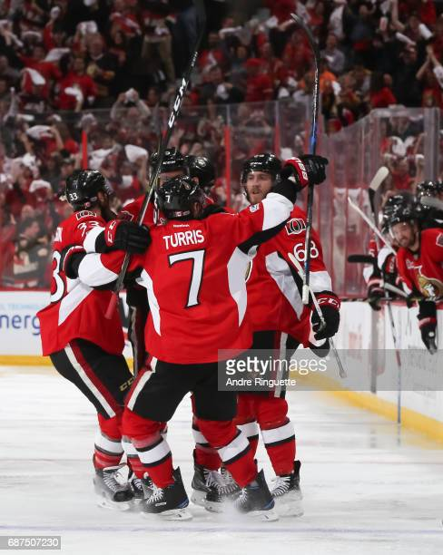 Mike Hoffman of the Ottawa Senators celebrates with teammates Fredrik Claesson and Kyle Turris after scoring a third period goal on the Pittsburgh...