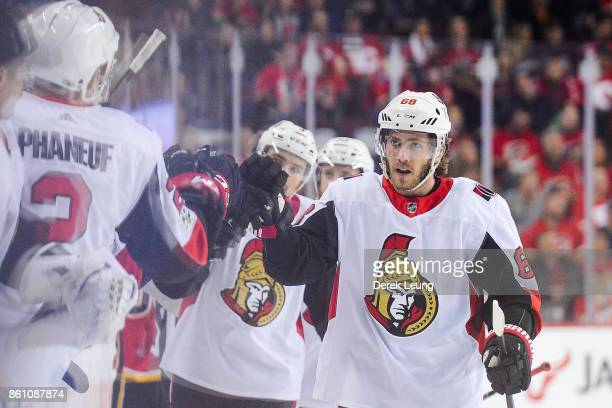 Mike Hoffman of the Ottawa Senators celebrates with the bench after scoring against the Calgary Flames during an NHL game at Scotiabank Saddledome on...