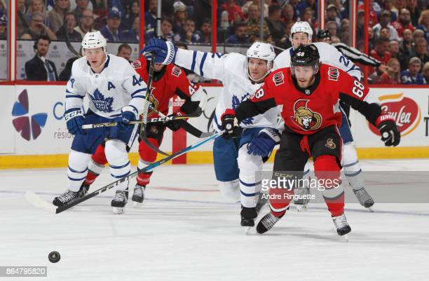 Mike Hoffman of the Ottawa Senators chases down the puck for a breakaway as Ron Hainsey of the Toronto Maple Leafs defends against at Canadian Tire...