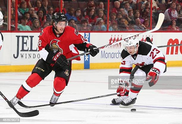 Mike Hoffman of the Ottawa Senators controls the puck against Tim Sestito of the New Jersey Devils at Canadian Tire Centre on April 10 2014 in Ottawa...