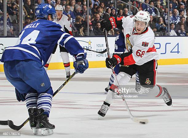 Mike Hoffman of the Ottawa Senators fires a shot against the Toronto Maple Leafs during an NHL game at the Air Canada Centre on October 10 2015 in...