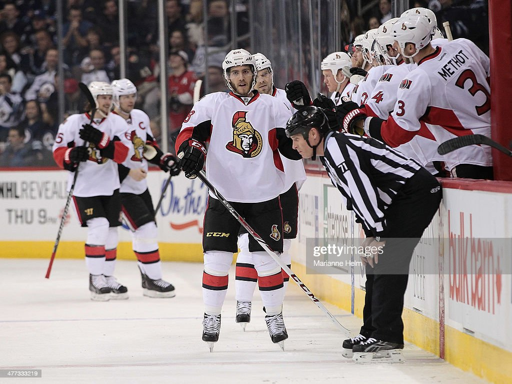 Mike Hoffman #68 of the Ottawa Senators is congratulated for his first NHL goal in second-period action in an NHL game against the Winnipeg Jets at the MTS Centre on March 8, 2014 in Winnipeg, Manitoba, Canada.