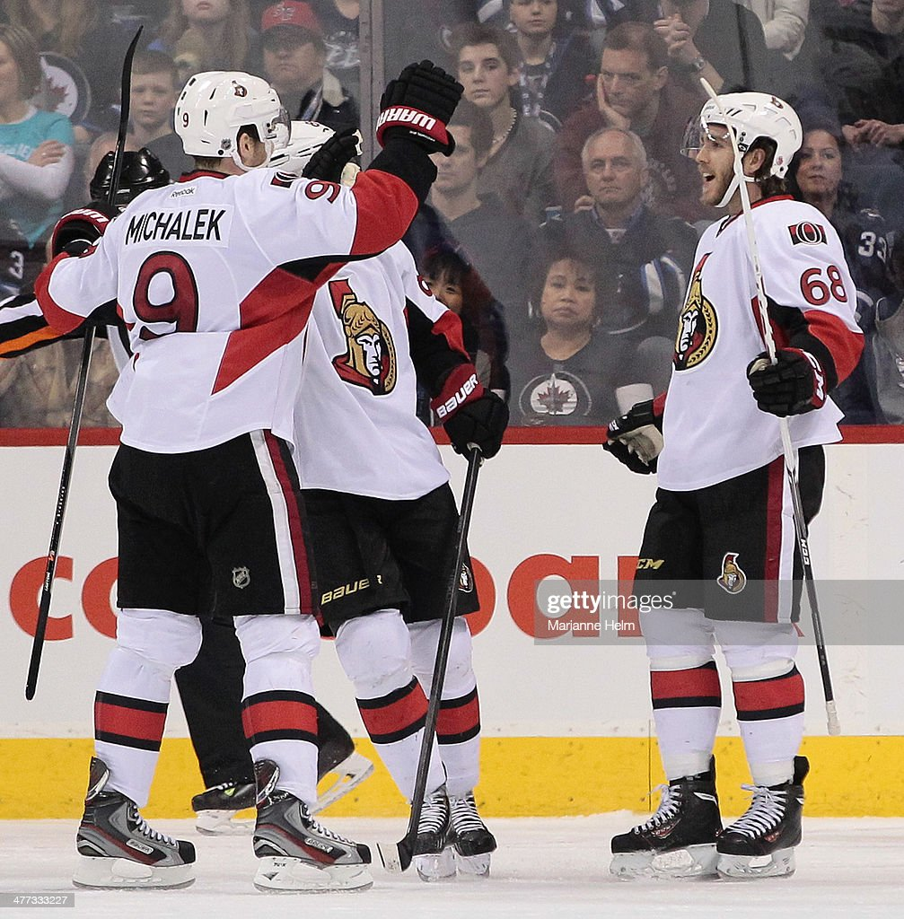 Mike Hoffman #68 of the Ottawa Senators is congratulated on his first NHL goal in second-period action in an NHL game against the Winnipeg Jets at the MTS Centre on March 8, 2014 in Winnipeg, Manitoba, Canada.