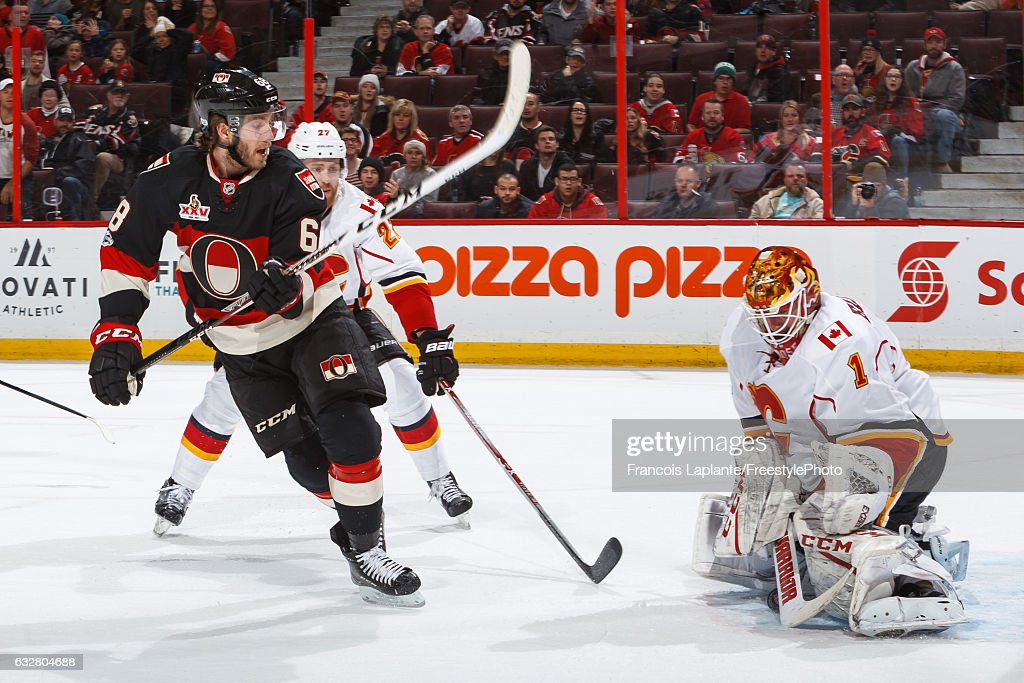 Mike Hoffman #68 of the Ottawa Senators makes a backhander shot against goalie Brian Elliott #1 of the Calgary Flames during an NHL game at Canadian Tire Centre on January 26, 2017 in Ottawa, Ontario, Canada.