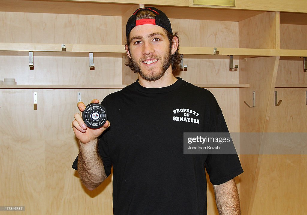 Mike Hoffman #68 of the Ottawa Senators poses with the puck from his first career NHL goal in a game against the Winnipeg Jets at the MTS Centre on March 8, 2014 in Winnipeg, Manitoba, Canada.