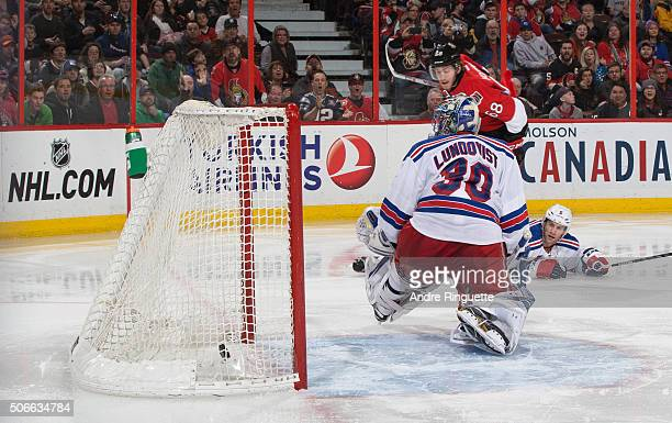 Mike Hoffman of the Ottawa Senators scores his second period goal against Henrik Lundqvist and Dan Girardi of the New York Rangers at Canadian Tire...