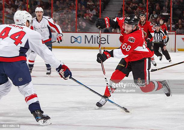 Mike Hoffman of the Ottawa Senators shoots the puck against Brooks Orpik of the Washington Capitals at Canadian Tire Centre on January 7 2017 in...