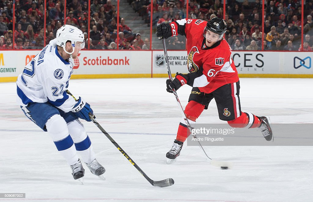 <a gi-track='captionPersonalityLinkClicked' href=/galleries/search?phrase=Mike+Hoffman+-+IJshockeyer+-+Left+wing&family=editorial&specificpeople=11427561 ng-click='$event.stopPropagation()'>Mike Hoffman</a> #68 of the Ottawa Senators shoots the puck against <a gi-track='captionPersonalityLinkClicked' href=/galleries/search?phrase=Erik+Condra&family=editorial&specificpeople=6254234 ng-click='$event.stopPropagation()'>Erik Condra</a> #22 of the Tampa Bay Lightning at Canadian Tire Centre on February 8, 2016 in Ottawa, Ontario, Canada.