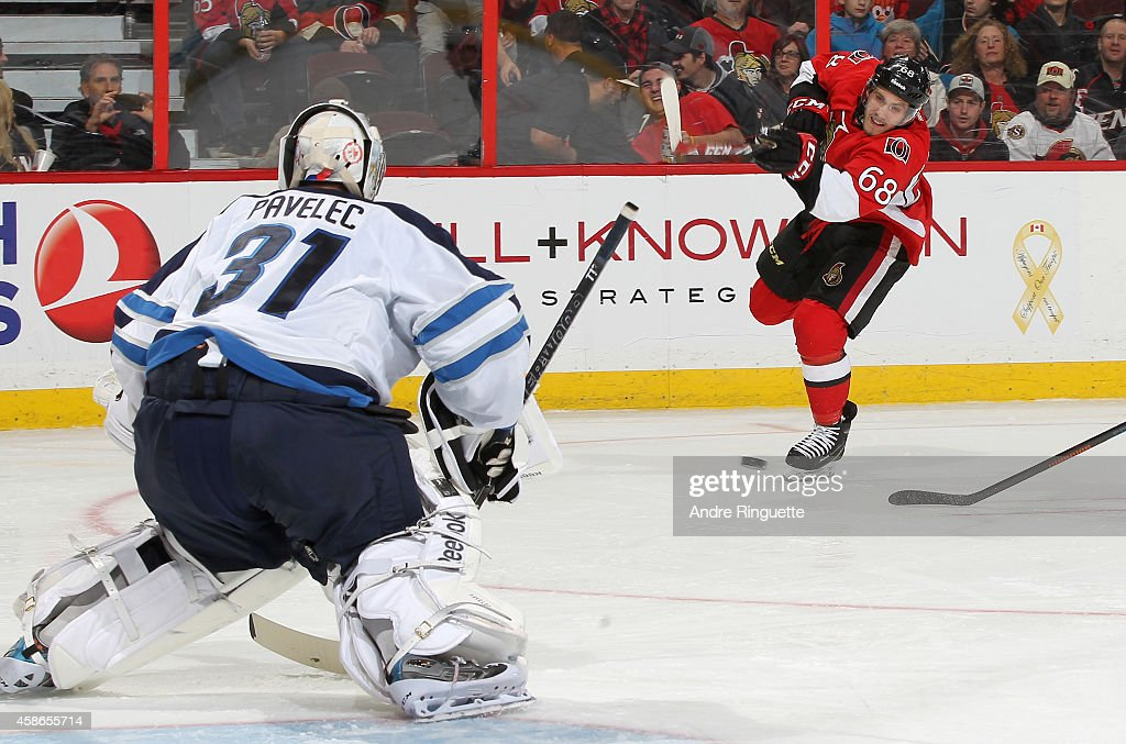 Mike Hoffman #68 of the Ottawa Senators shoots the puck against Ondrej Pavelec #31 of the Winnipeg Jets at Canadian Tire Centre on November 8, 2014 in Ottawa, Ontario, Canada.