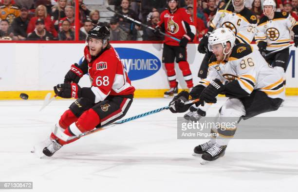 Mike Hoffman of the Ottawa Senators shoots the puck on a scoring chance as Kevan Miller of the Boston Bruins follows on the play in Game Five of the...