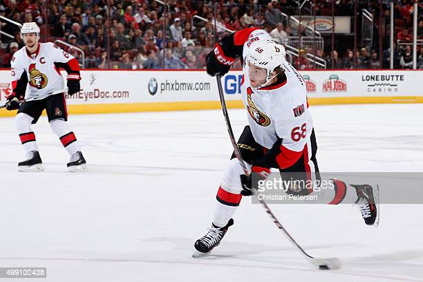 Mike Hoffman of the Ottawa Senators shoots to score a second period goal against the Arizona Coyotes during the NHL game at Gila River Arena on...