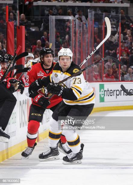 Mike Hoffman of the Ottawa Senators skates against Charlie McAvoy of the Boston Bruins in Game One of the Eastern Conference First Round during the...