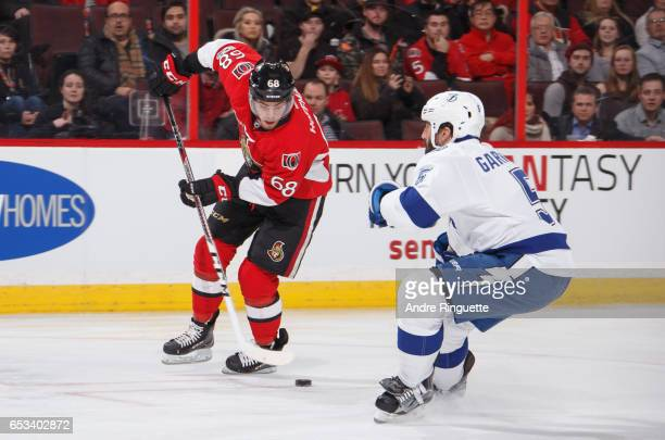 Mike Hoffman of the Ottawa Senators stickhandles the puck against Jason Garrison of the Tampa Bay Lightning at Canadian Tire Centre on March 14 2017...