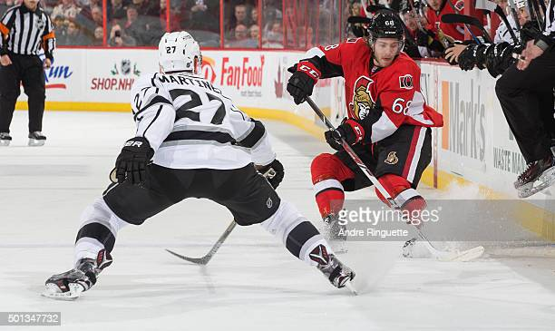 Mike Hoffman of the Ottawa Senators stickhandles the puck at the blue line against Alec Martinez of the Los Angeles Kings at Canadian Tire Centre on...