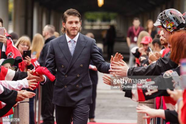 Mike Hoffman of the Ottawa Senators walks the red carpet prior to the start of a game against the Detroit Red Wings at Canadian Tire Centre on...