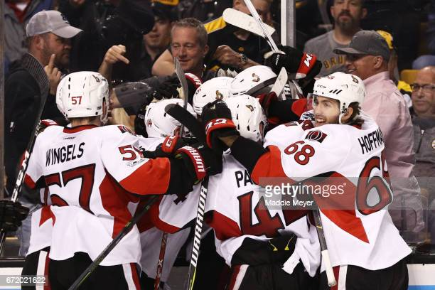 Mike Hoffman Tommy Wingels JeanGabriel Pageau and Alex Burrows celebrate with Clarke MacArthur of the Ottawa Senators after he scored the game...