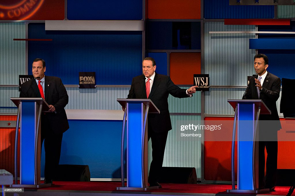 Mike Huckabee former Governor of Arkansas and 2016 Republican presidential candidate center and Bobby Jindal governor of Louisiana and 2016...