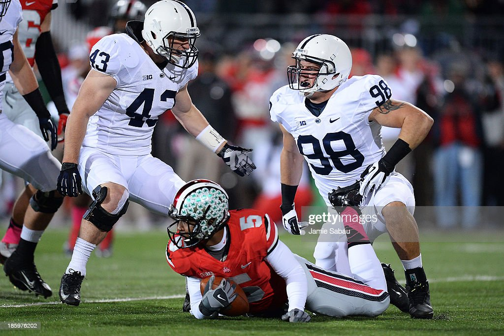 Mike Hull #43 of the Penn State Nittany Lions and Anthony Zettel #98 of the Penn State Nittany Lions celebrate after Zettel sacked quarterback Braxton Miller #5 of the Ohio State Buckeyes in the first quarter at Ohio Stadium on October 26, 2013 in Columbus, Ohio.