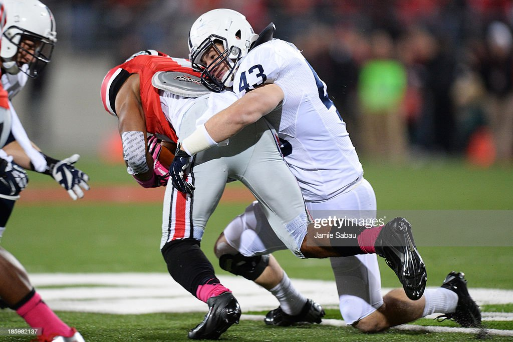 Mike Hull #43 of the Penn State Nittany Lions tackles Evan Spencer #6 of the Ohio State Buckeyes in the first half at Ohio Stadium on October 26, 2013 in Columbus, Ohio. Ohio State defeated Penn State 63-14.