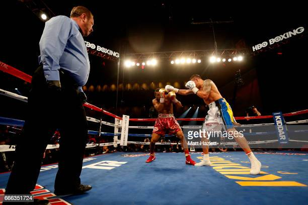 Mike Hunter exchanges punches with Aleksandr Usyk of Ukraine during their WBO Cruiserweight World Championship bout at The Theater at MGM National...