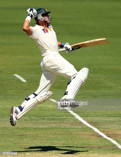 Mike Hussey of Australia celebrates scoring his century during day three of the Third Ashes Test match between Australia and England at the WACA on...