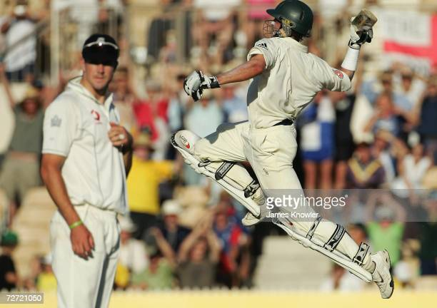 Mike Hussey of Australia jumps in celebration past Kevin Pietersen of England on day five of the second Ashes Test Match between Australia and...
