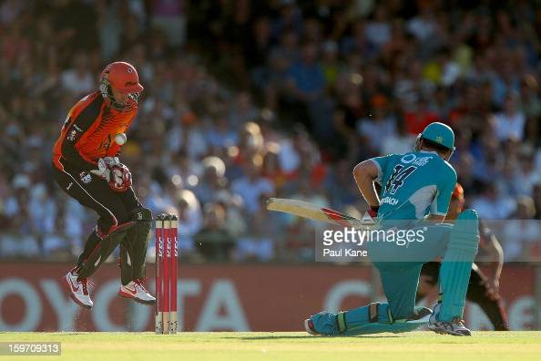 Mike Hussey of the Scorchers fumbles the ball during the Big Bash League final match between the Perth Scorchers and the Brisbane Heat at the WACA on...