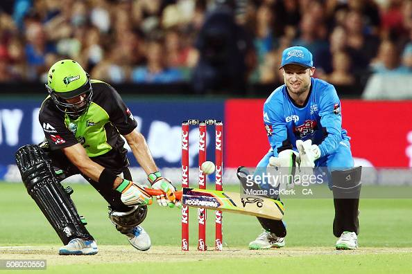 Mike Hussey of the Sydney Thunder plays a shot to get out as Tim Ludeman of the Adelaide Strikers looks on during the Big Bash League Semi Final...