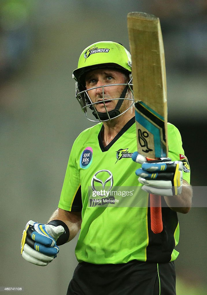 Mike Hussey of the Thunder acknowledges the crowd after being dismissed after scoring a half century during the Big Bash League match between the Sydney Thunder and Brisbane Heat at ANZ Stadium on December 21, 2014 in Sydney, Australia.