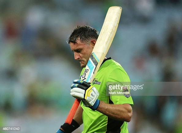 Mike Hussey of the Thunder acknowledges the crowd after being dismissed after scoring a half century during the Big Bash League match between the...