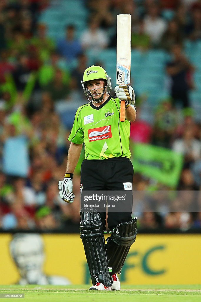 Mike Hussey of the Thunder celebrates after scoring a half century during the Big Bash League match between Sydney Thunder and the Adelaide Strikers at ANZ Stadium on December 27, 2013 in Sydney, Australia.