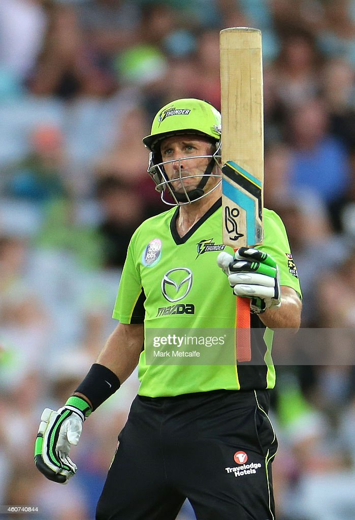 Mike Hussey of the Thunder celebrates and acknowledges the crowd after scoring a half century during the Big Bash League match between the Sydney Thunder and Brisbane Heat at ANZ Stadium on December 21, 2014 in Sydney, Australia.