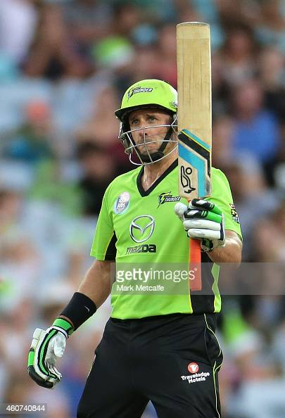 Mike Hussey of the Thunder celebrates and acknowledges the crowd after scoring a half century during the Big Bash League match between the Sydney...