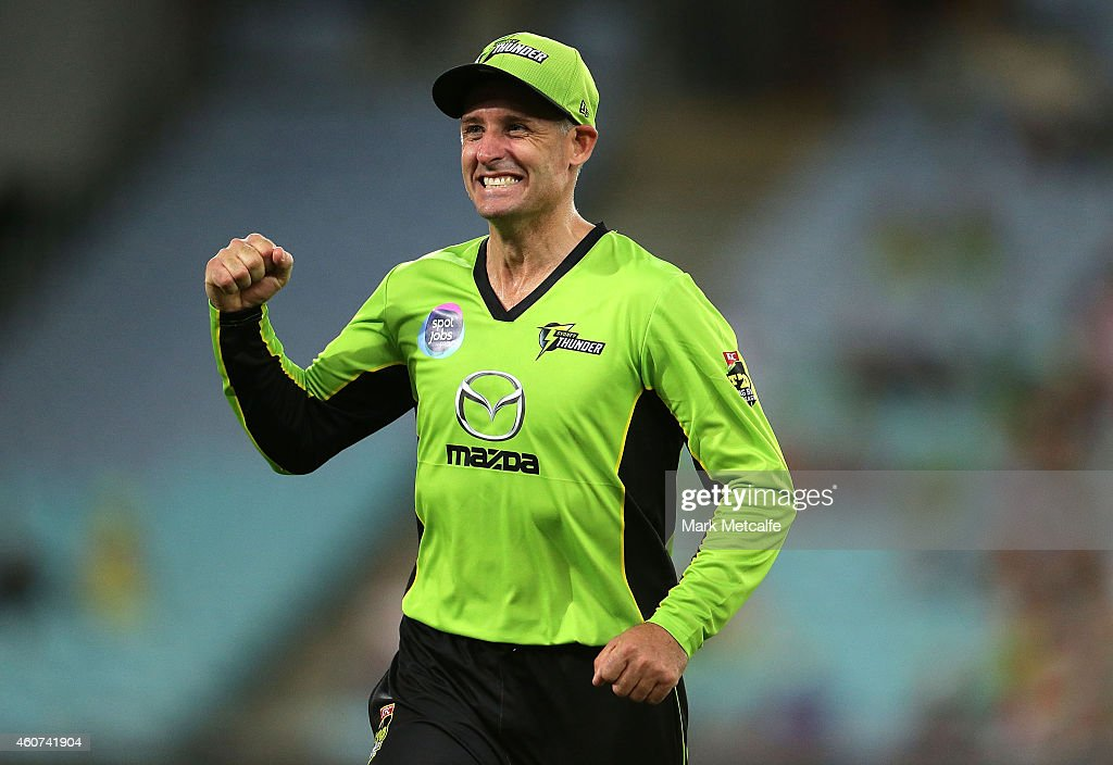 Mike Hussey of the Thunder celebrates the wicket of Andrew Flintoff of the Heat during the Big Bash League match between the Sydney Thunder and Brisbane Heat at ANZ Stadium on December 21, 2014 in Sydney, Australia.