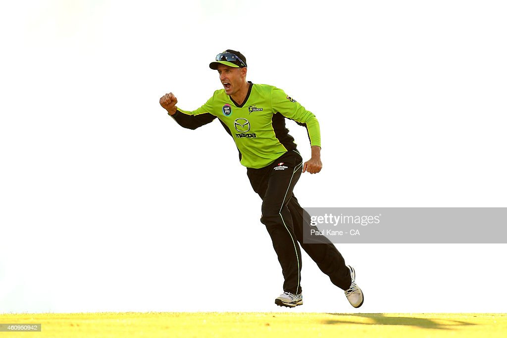 Mike Hussey of the Thunder celebrates the wicket of Sam Whiteman of the Scorchers during the Big Bash League match between the Perth Scorchers and Sydney Thunder at WACA on January 1, 2015 in Perth, Australia.