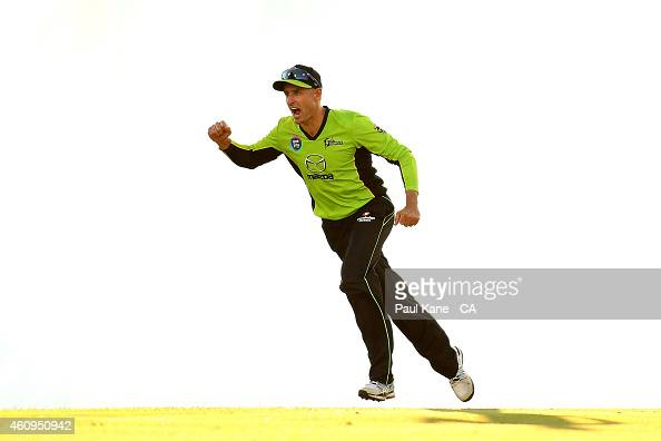 Mike Hussey of the Thunder celebrates the wicket of Sam Whiteman of the Scorchers during the Big Bash League match between the Perth Scorchers and...